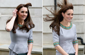 The Duchess of Cambridge struggling to contain her irrepressible locks at Place2Be Headteacher Conference in London.