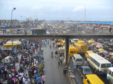 A view of a busy district of Lagos from a flyover bridge.
