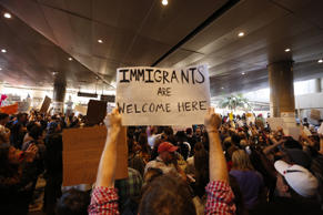 Hundreds of people continue to protest President Donald Trump's travel ban at the Tom Bradley International Terminal at LAX on January 29, 2017 in Los Angeles, California.