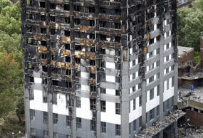 The burnt Grenfell Tower apartment building standing testament to the recent fire in London