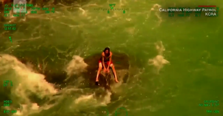 Swimmer stranded in rapids