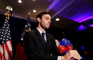 Democratic candidate for 6th congressional district Jon Ossoff adjusts his microphone as he concedes to Republican Karen Handel at his election night party in Atlanta, Tuesday, June 20, 2017.