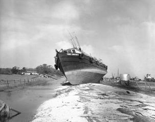 The fishing scooner three brothers rests high and dry on a road after it was tossed from the water as hurricane Audrey ripped through south Louisiana coastal town in Cameron, La., on June 28, 1957. Many boats were tossed ashore or sunk during the first hurricane of the season.