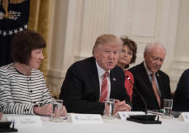 US President Donald Trump is flanked by US Senators Susan Collins (L) of Maine, Lisa Murkowski (2nd R) of Alaska and Orrin Hatch of Utah (R) as Republican senators meet with Trump to discuss the healthcare bill at the White House in Washington, DC, on June 27, 2017.