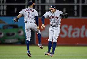 Carlos Correa #1 and George Springer #4 of the Houston Astros celebrates defeating the Oakland Athletics 8-4 at Oakland Alameda Coliseum on June 20, 2017 in Oakland, California.