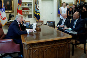 National Security Adviser H.R. McMaster and National Economic Council Director Gary Cohn watch as President Donald Trump talks with new Irish Prime Minister Leo Varadkar during a telephone call, Tuesday, June 27, 2017, in the Oval Office of the White House in Washington.