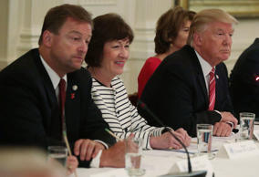U.S. President Donald Trump (R) speaks as Sen. Dean Heller (R-NV) (L) and Sen. Susan Collins (R-ME) (2nd L) listen during a meeting with Senate Republicans at the East Room of the White House June 27, 2017 in Washington, DC. President Trump invited all GOP Senate members to the White House to discuss the Health Care bill.