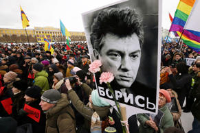 Participants in February march in memory of Russian politician Boris Nemtsov in St. Petersburg on the eve of the 2nd anniversary of his death.
