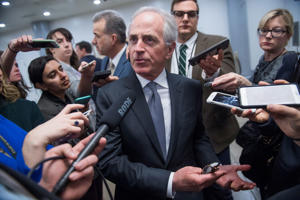 Sen. Bob Corker, R-Tenn., talks with reporters in the senate subway after a vote in the senate, March 2, 2017.