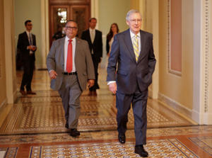 In this July 13, 2017 file photo, Senate Majority Leader Mitch McConnell of Ky. walks to his office on Capitol Hill in Washington. Republicans' latest health care plan would create winners and losers among Americans up and down the income ladder, and across age groups.