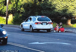 Mother arrested for towing her kids in a plastic red wagon behind her car
