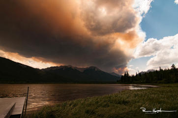 On Sunday, July 16, 2017, this cloud started to roll into the Banff at roughly 2pm. As a result of the British Columbia and recent Banff Park fires, the sky took on a strange orange hue. This was taken over Vermillion Lakes, just west of the Banff townsite.
