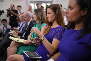 CAPTION: WASHINGTON, DC - JULY 17: Reporters listen to White House Press Secretary Sean Spicer during an off-camera briefing in the Brady Press Briefing Room at the White House July 17, 2017 in Washington, DC. The White House has not held an on-camera briefing since June 29. (Photo by Chip Somodevilla/Getty Images)