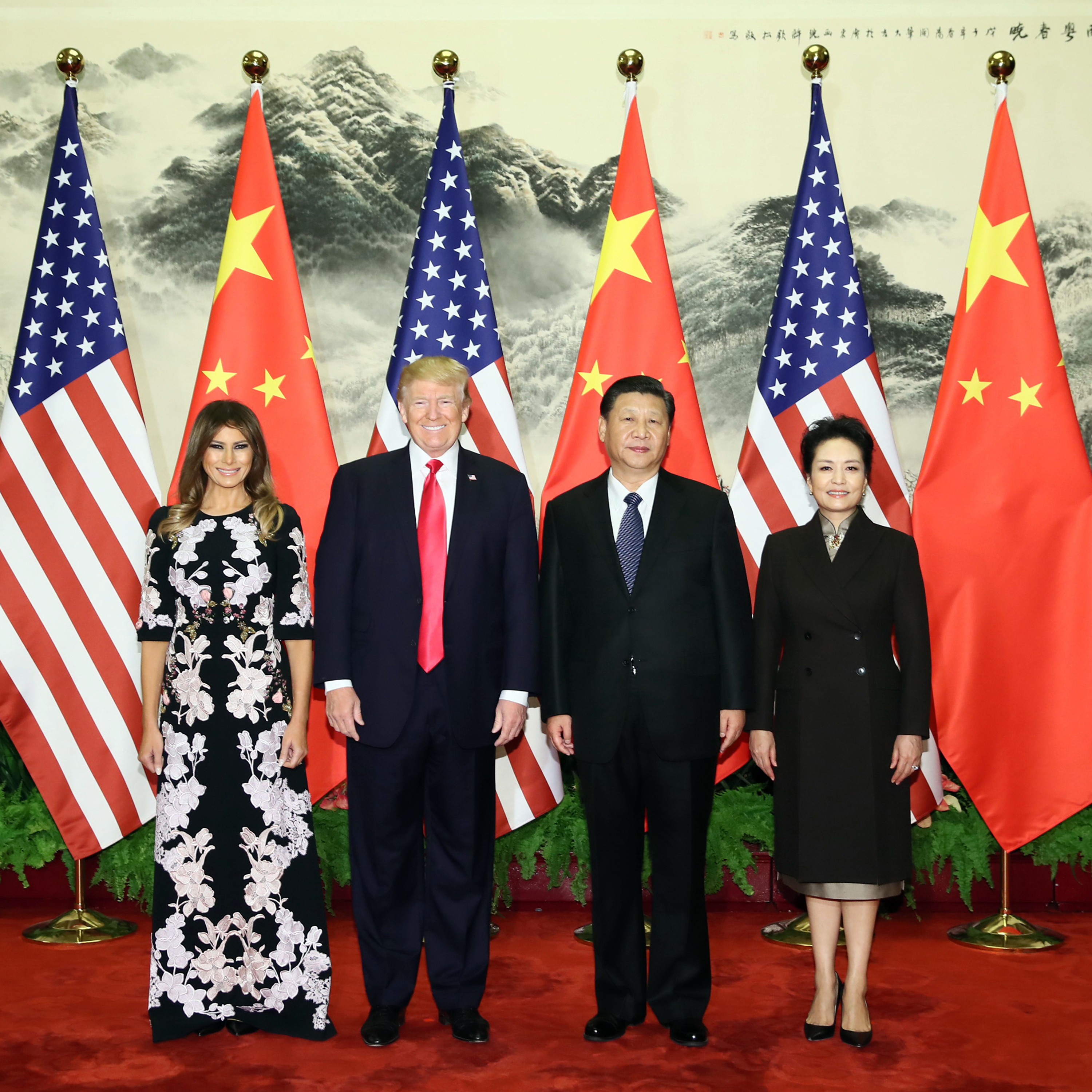Chinese President Xi Jinping (2nd R) and his wife Peng Liyuan (1st R), and U.S. President Donald Trump (2nd L) and his wife Melania Trump pose for group photos at the Great Hall of the People in Beijing, capital of China, Nov. 9, 2017. Xi held a grand ceremony to welcome Trump on Thursday.