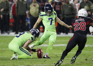 Seattle Seahawks kicker Blair Walsh (7) kicks a field goal as punter Jon Ryan (9) holds during the first half of an NFL football game against the Arizona Cardinals, Thursday, Nov. 9, 2017, in Glendale, Ariz.