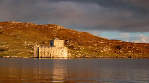 Kisimul Castle on the island of Barra, one of the outer hebrides islands in the evening sun.