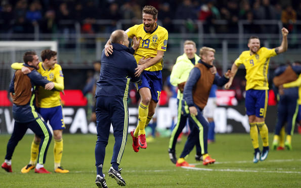 Sweden's players celebrate at the end of the World Cup qualifying play-off second leg soccer match between Italy and Sweden, at the Milan San Siro stadium, Italy, Monday, Nov. 13, 2017. Four-time champion Italy has failed to qualify for World Cup; Sweden advances with 1-0 aggregate win in playoff.
