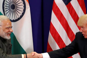 U.S. President Donald Trump shakes hands as he holds a bilateral meeting with India's Prime Minister Narendra Modi alongside the ASEAN Summit in Manila, Philippines November 13, 2017.