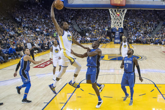 Slide 1 of 17: November 13, 2017; Oakland, CA, USA; Golden State Warriors forward Kevin Durant (35) dunks the basketball against the Orlando Magic during the second half at Oracle Arena.