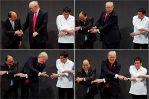 "In a combination photo, U.S. President Donald Trump registers his surprise as he realizes other leaders, including Vietnam's Prime Minister Nguyen Xuan Phuc and President of the Philippines Rodrigo Duterte, are crossing their arms for the traditional ""ASEAN handshake"" as he participates in the opening ceremony of the ASEAN Summit in Manila, Philippines November 13, 2017. REUTERS/Jonathan Ernst TPX IMAGES OF THE DAY"