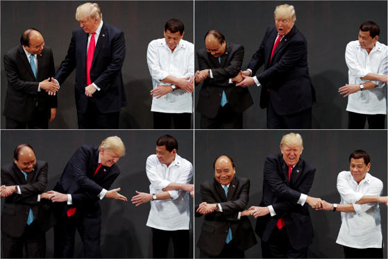 "Bild 2 av 27: In a combination photo, U.S. President Donald Trump registers his surprise as he realizes other leaders, including Vietnam's Prime Minister Nguyen Xuan Phuc and President of the Philippines Rodrigo Duterte, are crossing their arms for the traditional ""ASEAN handshake"" as he participates in the opening ceremony of the ASEAN Summit in Manila, Philippines November 13, 2017. REUTERS/Jonathan Ernst TPX IMAGES OF THE DAY"