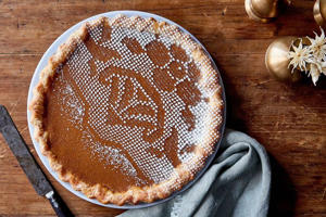 a wooden table topped with a cut in half: Pumpkin Sugar Pie