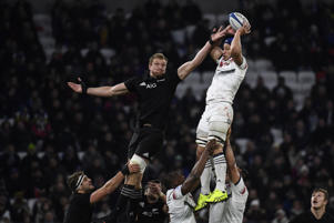 France's flanker Wenceslas Lauret (R) jumps and catches the ball against New Zealand's N°8 Ardie Savea (L) during the international rugby union test match between France and the New Zealand All Blacks at Groupama Stadium in Decines-Charpieu, near Lyon.