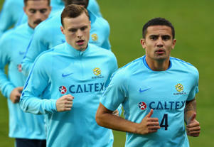 Tim Cahill of the Socceroos warms up with teammates during an Australian Socceroos training session