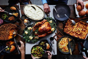 a group of people sitting at a table with a plate of food: Food52's Automagic Thanksgiving Menu Maker Is Here!