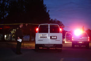 A Tehama County Coroner's van enters the Rancho Tehama Elementary school grounds after a shooting on November 14, 2017, in Rancho Tehama, California.