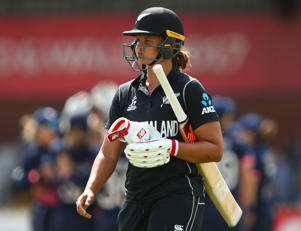 Suzie Bates of New Zealand leaves the field after losing her wicket to Alex Hartley of England.