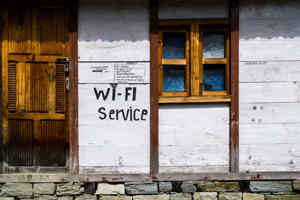 CHAME, MANANG DISTRICT, NEPAL - 2016/08/24: A tourist lodge with a wifi service sign at the buildings wall. (Photo by Frank Bienewald/LightRocket via Getty Images)