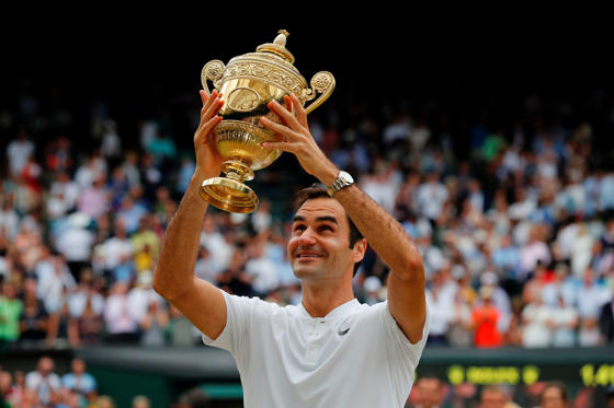 Slide 1 of 22: TOPSHOT - Switzerland's Roger Federer holds the winner's trophy after beating Croatia's Marin Cilic in their men's singles final match, during the presentation on the last day of the 2017 Wimbledon Championships at The All England Lawn Tennis Club in Wimbledon, southwest London, on July 16, 2017. Roger Federer won 6-3, 6-1, 6-4.  / AFP PHOTO / Adrian DENNIS / RESTRICTED TO EDITORIAL USE        (Photo credit should read ADRIAN DENNIS/AFP/Getty Images)