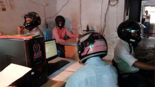 Govt employees wear helmet inside office in Bihar