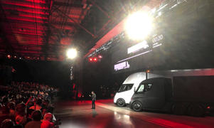 Tesla CEO Elon Musk shows off the Tesla Semi as he unveils the company's new electric semi truck during a presentation in Hawthorn, California, U.S., Nov. 16.