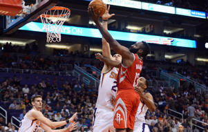 Nov 16, 2017; Phoenix, AZ, USA; Houston Rockets guard James Harden (13) puts up a layup over Phoenix Suns center Alex Len (21) during the second half at Talking Stick Resort Arena.