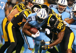 Nov 16, 2017; Pittsburgh, PA, USA; Tennessee Titans running back DeMarco Murray (29) is tackled by the Pittsburgh Steelers defense during the first quarter at Heinz Field.