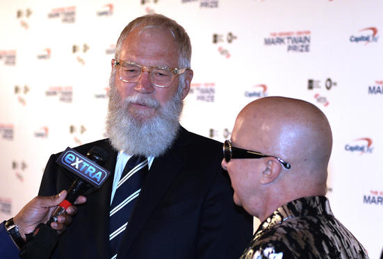 Slide 1 of 21: Honoree David Letterman (L) does an interview next to musician Paul Shaffer at the 20th Annual Mark Twain Prize for American Humor at the Kennedy Center in Washington, DC, on October 22, 2017.  / AFP PHOTO / ANDREW CABALLERO-REYNOLDS