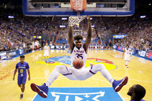 LAWRENCE, KS - NOVEMBER 17:  Udoka Azubuike #35 of the Kansas Jayhawks dunks during the 1st half of the game against the South Dakota State Jackrabbits at Allen Fieldhouse on November 17, 2017 in Lawrence, Kansas.  (Photo by Jamie Squire/Getty Images)