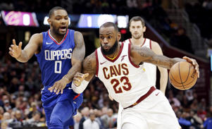 Cleveland Cavaliers' LeBron James (23) drives past Los Angeles Clippers' Sindarius Thornwell (0) during the first half of an NBA basketball game, Friday, Nov. 17, 2017, in Cleveland. (AP Photo/Tony Dejak)