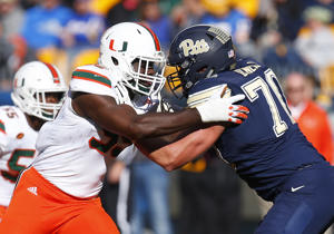 PITTSBURGH, PA - NOVEMBER 24:  Joe Jackson #99 of the Miami Hurricanes in action against Brian O'Neill #70 of the Pittsburgh Panthers on November 24, 2017 at Heinz Field in Pittsburgh, Pennsylvania.  (Photo by Justin K. Aller/Getty Images)