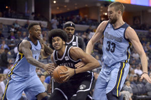 Brooklyn Nets center Jarrett Allen, center, drives between Memphis Grizzlies center Marc Gasol (33) and forward Jarell Martin (1) in the first half of an NBA basketball game, Sunday, Nov. 26, 2017, in Memphis, Tenn.