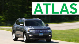 a car that has a sign on the side of a road: 2018 Volkswagen Atlas Road Test