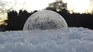 a close up of a building: Mesmerising footage of a bubble freezing