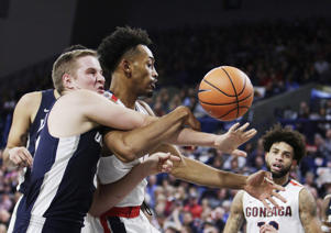 Utah State guard Sam Merrill, left, and Gonzaga forward Johnathan Williams go after a rebound during the first half of an NCAA college basketball game in Spokane, Wash., Saturday, Nov. 18, 2017. (AP Photo/Young Kwak)