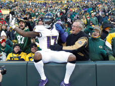 Ravens' Mike Wallace celebrates in the stands at Lambeau Field after catching a touchdown pass during the second half of an NFL football game against the Green Bay Packers Sunday, Nov. 19, 2017, in Green Bay, Wis.