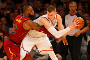 Kristaps Porzingis of the New York Knicks in action against LeBron James of the Cleveland Cavaliers at Madison Square Garden on Nov. 13, 2017 in New York.