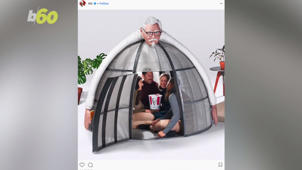 a man standing in front of a mirror posing for the camera: KFC Selling $10,000 'Internet Escape Pod' (It's a Tent)