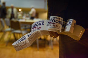 Daniel Burns hands out Roy Moore campaign material at the Madison County Republican Mens Club monthly breakfast at Trinity United Methodist Church on Saturday, November 18, 2017, in Huntsville, AL. Most attendees showed their open support of U.S. Senate candidate Roy Moore of Alabama.