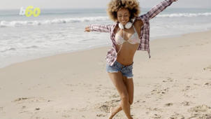 a woman standing on a beach: More Women Are Content While Single Than Men, Study Says